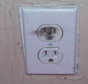 what does it mean when an electrical outlet sparks